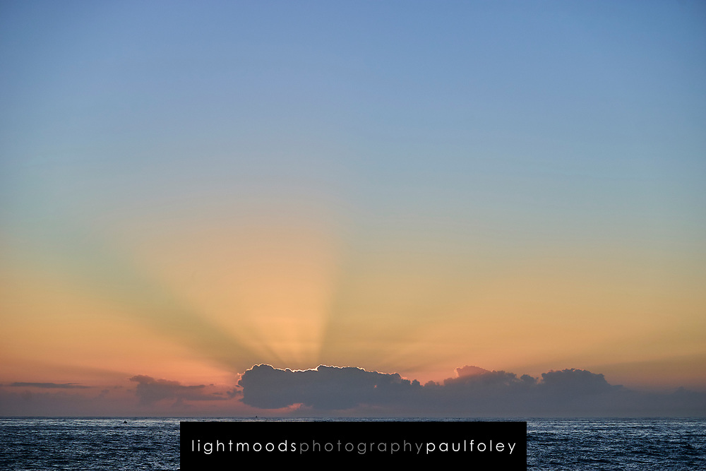 Sunrise behind clouds over the Pacific Ocean at Newcastle Australia