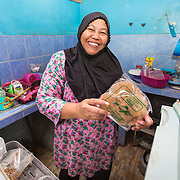 CAPTION: Floods can have a devastating effect on the community, with many belongings getting washed away or damaged. In a previous flood, Khoiriyah's fridge was damaged along with many other household items. LOCATION: Wonosari, Semarang, Indonesia. INDIVIDUAL(S) PHOTOGRAPHED: Khoiriyah.