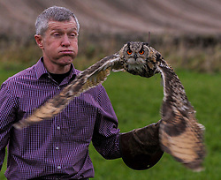 Pictured: Scottish Liberal Democrat leader Willie Rennie tried his hand at falconry on a visit to Elite Falconry in Cluny, Fife, where he met Indian Eagle Owl Sage and Golden Eagle Stanley.<br /> <br /> © Dave Johnston / EEm