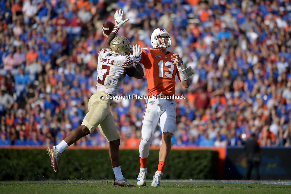 Florida quarterback Feleipe Franks (13) throws a pass while under pressure from Florida State defensive back Derwin James (3) during the second half of an NCAA college football game Saturday, Nov. 25, 2017, in Gainesville, Fla. FSU won 38-22. (Photo by Phelan M. Ebenhack)