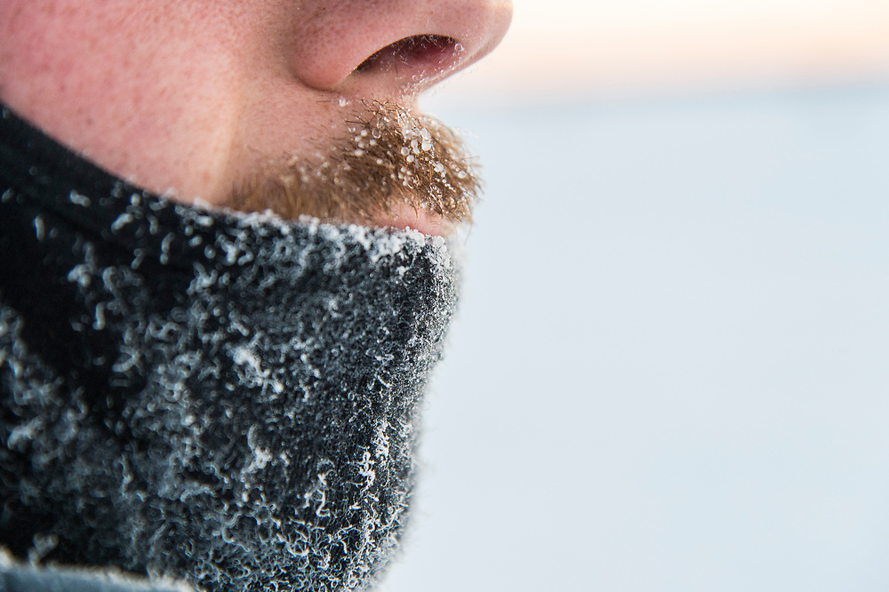 An ice fisherman's frosty face while fishing on Little Bay de Noc near Gladstone and Escanaba, Michigan.