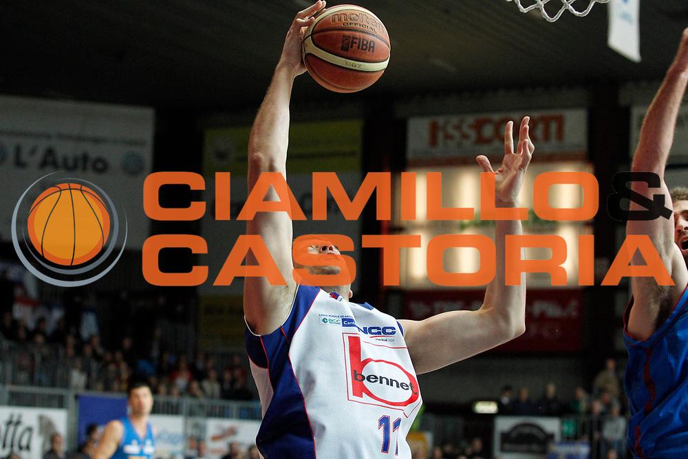 DESCRIZIONE : Cantu Campionato Lega A 2011-12 Bennet Cantu Novipiu Casale Monferrato<br /> GIOCATORE : Denis Marconato<br /> CATEGORIA : Rimbalzo<br /> SQUADRA : Bennet Cantu<br /> EVENTO : Campionato Lega A 2011-2012<br /> GARA : Bennet Cantu Novipiu Casale Monferrato<br /> DATA : 06/04/2012<br /> SPORT : Pallacanestro<br /> AUTORE : Agenzia Ciamillo-Castoria/G.Cottini<br /> Galleria : Lega Basket A 2011-2012<br /> Fotonotizia : Cantu Campionato Lega A 2011-12 Bennet Cantu Novipiu Casale Monferrato<br /> Predefinita :