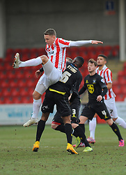 Cheltenham Town's Eliot Richards loses the ball to Bury's Kelvin Etuhu- Photo mandatory by-line: Nizaam Jones - Mobile: 07966 386802 - 14/02/2015 - SPORT - Football - Cheltenham - Whaddon Road - Cheltenham Town v Bury - Sky Bet League Two