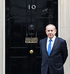 Downing Street, London, February 6th 2017. Israeli Prime Minister Benjamin Netanyahu arrives at 10 Downing Street for lunchtime talks with British Prime Minister Theresa May, with some confusion arising when Mrs May was not immediately on hand to welcome him. Minutes later the two PMs emerged for the traditional handshake photographs at the door of No 10. PICTURED: A slightly bemused Netanyahu poses in front of the door of No 10 as he waits to be welcomed by Theresa May.