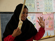 Teacher Asya Hassan Mussa is teaching a class full of primary school children at Saateni nursery school, Zanzibar, Tanzania. Teacher Asya was taught by VSO volunteer teacher trainer, Daphne Sharp. Daphne has now trained over 100 nusery school teachers and 18 heads of pre school.