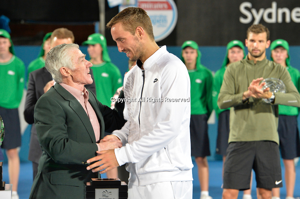 16.01.16 Sydney, Australia. Viktor Troicki (SRB) wins the mens singles title defeating Grigor Dimitrov (BUL) in the mens singles final match at the Apia International Sydney. He receives the trophy from Ken Roewall. Troicki won the final 2-6,6-1,7-6.