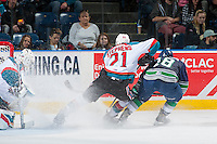 KELOWNA, CANADA - FEBRUARY 13: Devante Stephens #21 of the Kelowna Rockets checks Sami Moilanen #18 of the Seattle Thunderbirds on February 13, 2017 at Prospera Place in Kelowna, British Columbia, Canada.  (Photo by Marissa Baecker/Shoot the Breeze)  *** Local Caption ***