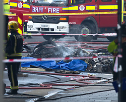 Helicopter crash in Vauxhall, London, UK. January 16, 2013. Smouldering wreckage from the scene. Photo by i-Images.