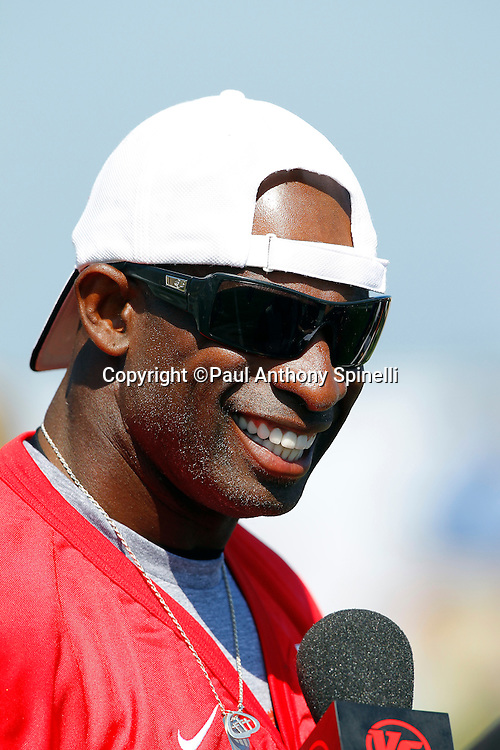 Former Dallas Cowboys cornerback Deion Sanders (21) of the Gamers team smiles during a media interview as he gets ready to play flag football in the EA Sports Madden NFL 11 Launch celebrity and NFL player flag football game held at Malibu Bluffs State Park on July 22, 2010 in Malibu, California. (©Paul Anthony Spinelli)
