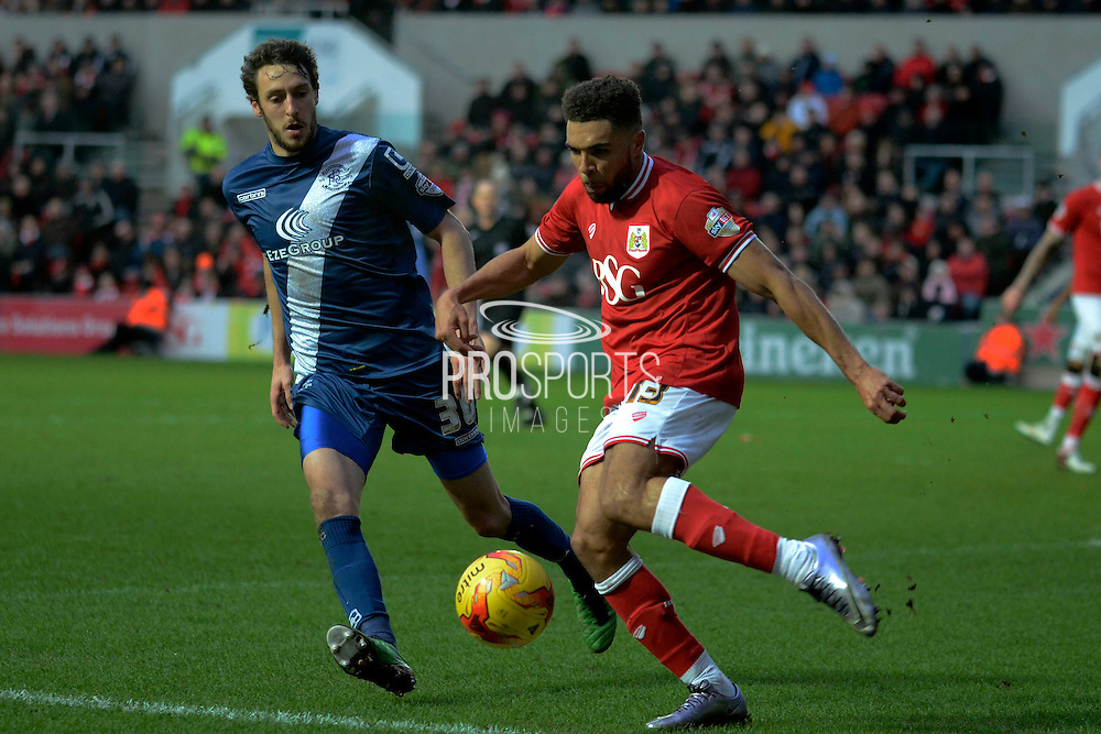 Bristol City defender Scott Golbourne clears the ball from Birmingham City midfielder Will Buckley during the Sky Bet Championship match between Bristol City and Birmingham City at Ashton Gate, Bristol, England on 30 January 2016. Photo by Alan Franklin.