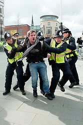 "Protestor is grabbed by police after crossing the ""Ring of Steel"" fence in Barkers Pool, outside Sheffield city Hall where the Liberal Democrats are holding their Party conference Conference Sheffield Saturday.12 March 2011.Images © Paul David Drabble"