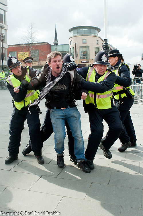 """Protestor is grabbed by police after crossing the """"Ring of Steel"""" fence in Barkers Pool, outside Sheffield city Hall where the Liberal Democrats are holding their Party conference Conference Sheffield Saturday.12 March 2011.Images © Paul David Drabble"""