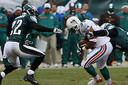 PHILADELPHIA - NOVEMBER 18: The Philadelphia Eagles bring down a run during the game against the Miami Dolphins on November 18, 2007 at Lincoln Financial Field in Philadelphia, Pennsylvania.