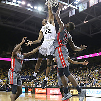 ORLANDO, FL - NOVEMBER 15: Chance McSpadden #22 of the UCF Knights grabs a rebound in front of L'Hassane Niangane #31 of the Gardner Webb Runnin Bulldogs during a NCAA basketball game at the CFE Arena on November 15, 2017 in Orlando, Florida. (Photo by Alex Menendez/Getty Images) *** Local Caption *** Chance McSpadden; L'Hassane Niangane