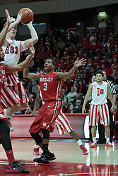 15 February 2014:  Matt Stacho heads straight to the hoop down the lane defended and eventually double teamed by Chris Blake and Anthony Fields and takes a shot that results in 2 points during an NCAA Missouri Valley Conference (MVC) mens basketball game between the Bradley Braves and the Illinois State Redbirds  in Redbird Arena, Normal IL.