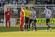 York City midfielder Russell Penn receives a caution  during the Sky Bet League 2 match between Notts County and York City at Meadow Lane, Nottingham, England on 26 September 2015. Photo by Simon Davies.