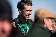 Democratic 2020 presidential candidate Beto O'Rourke, 46, speaks with supporters after finishing a St. Patrick's Day 5K race during a three day road trip across Iowa, in North Liberty, Iowa, U.S., March 16, 2019.  REUTERS/Ben Brewer