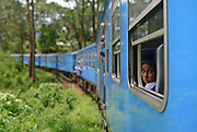 Portrait of young boy during train ride from Kandy to Nuwara Eliya, Sri Lanka