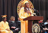 Valedictorian Airiana Bolton speaks during the Meadowdale High School commencement in their gym in Dayton, Tuesday, May 22, 2012.