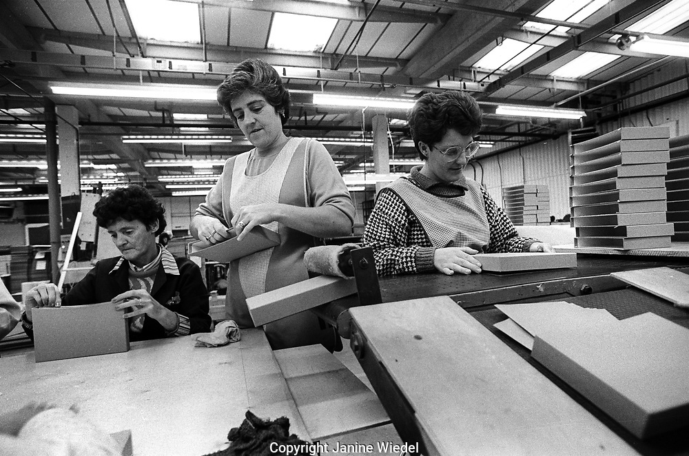 People working in the Fancy Box company factory.