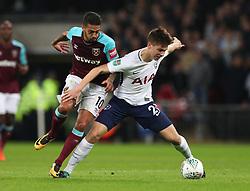 Tottenham Hotspur's Juan Foyth (right) and West Ham United's Manuel Lanzini battle for the ball