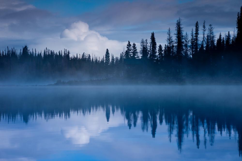 Mist on Three Creek Lake at dawn near Sisters in central Oregon