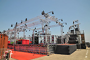 construction of an Outdoor music festival stage with lighting arches