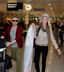 Ronan Keating and Australian girlfriend Storm Uechtritz, Heathrow Airport, United Kingdom. Wednesday, 7th May 2014. Picture by David Dyson / i-Images