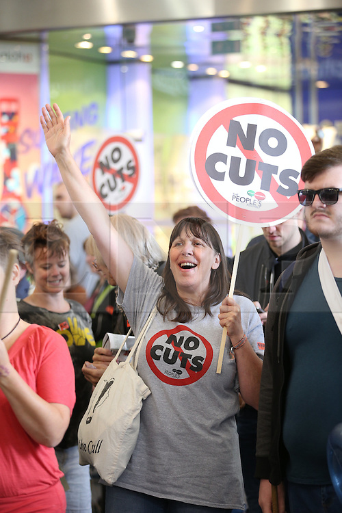 © Licensed to London News Pictures . 08/07/2015 . Manchester , UK . A demonstration against today's (8th July 2015) budget , organised by the People's Assembly , in Manchester City Centre . Photo credit: Joel Goodman/LNP