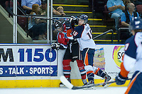 KELOWNA, CANADA - AUGUST 30: Collin Shirley #15 of the Kamloops Blazers checks Kelowna Rockets prospect #29 Jordan Borstmayer into the boards on August 30, 2014 during pre-season at Prospera Place in Kelowna, British Columbia, Canada.   (Photo by Marissa Baecker/Shoot the Breeze)  *** Local Caption *** Collin Shirley; Jordan Borstmayer;