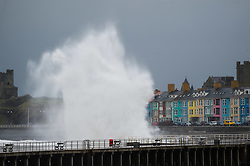 © London News Pictures. 26/03/2016 Aberystwyth, Wales, UK. Storms force winds bring enormous waves to batter Aberystwyth on Easter Saturday as a band of wet and windy weather affects much of England and Wales. Met Office 'yellow' warnings are in place for most of the country for the Easter weekend. Saturday is set to be a  blustery day, with gusts of 55mph expected in some areas, rising to 65mph in coastal areas.. Photo credit: Keith Morris/LNP