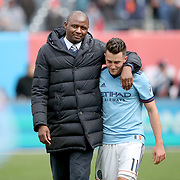 NEW YORK, NEW YORK - April 12: New York City FC head Coach Patrick Vieira with Jack Harrison #11 of New York City FC leaving the field after their sides 2-1 win which included a goal from Jack Harrison during the New York City FC Vs San Jose Earthquakes regular season MLS game at Yankee Stadium on April 1, 2017 in New York City. (Photo by Tim Clayton/Corbis via Getty Images)