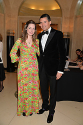 ROSE FARQUHAR and EDWARD TAYLOR at the Tusk Friends Dinner in aid of wildlife charity Tusk held at Claridge's, Brook Street, London on 11th March 2014.