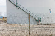 a oil storage tank behind barbed wire in France Provence