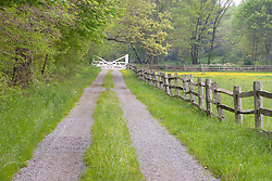 A split rail fence and farm road in Ipswich Massachusetts USA