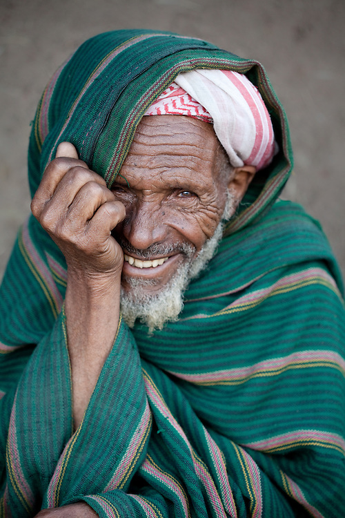 A smiling elderly muslim man in Dinsho, a small town nestled in the Bale Mountains of Ethiopia