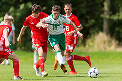 WREXHAM, WALES - Thursday, August 15, 2019: Wales' Calum Agius and Northern Ireland's Shea Brennan during the UEFA Under-15's Development Tournament match between Wales and Northern Ireland at Colliers Park. (Pic by Paul Greenwood/Propaganda)