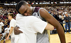 Texas A&M's Danuel House (23) celebrates a regular season Southeastern Conference championship with a teammate after defeating Vanderbilt in an NCAA college basketball game, Saturday, March 5, 2016, in College Station, Texas. Texas A&M won 76-67. (AP Photo/Sam Craft)