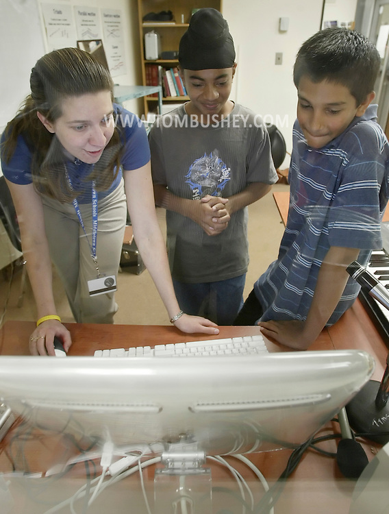 Twin Towers Middle School teacher Amanda Mita, left, helps students Harjit Singh and Vivek Sood in the school's recording studio in Middletown on May 17, 2007.