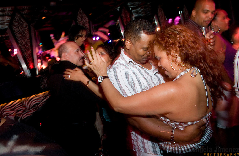 Date: 7/19/09.Desk: WKD.Slug: LATIN2.Assign Id: 30082726A...Patrons dance as Jose Peña Suazo performs with his group La Banda Gorda at the El Morocco club in Hamilton Heights, Manhattan in the early morning (around 4 am) on July 19, 2009....Photo by Angela Jimenez for The New York Times .photographer contact 917-586-0916