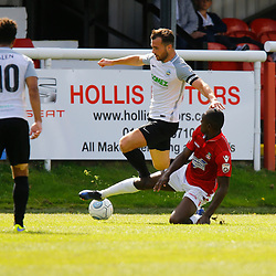 AUGUST 12:  Dover Athletic against Wrexham in Conference Premier at Crabble Stadium in Dover, England. Dover's midfielder Mitch Brundle evades a sliding challenge from Wrexham's defender Manny Smith. (Photo by Matt Bristow/mattbristow.net)