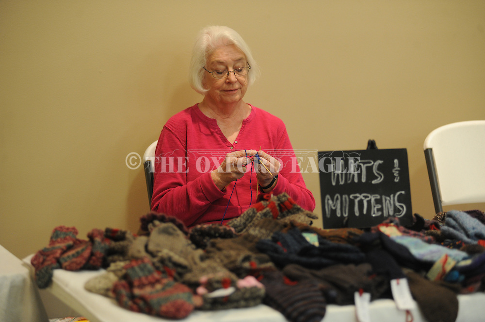 Carol Thweatt knits while working her booth during the annual Mississippi Homemakers Volunteers' Holiday House at North Oxford Baptist Church's activity center, in Oxford, Miss. on Friday, October 24, 2014.