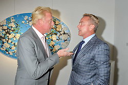 Left to right, BORIS BECKER and MICHAEL FLATLEY at a private view of woks by German artist Mike Dargas held at the Opera Gallery, 134 New Bond Street, London on 5th July 2016.
