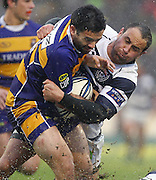 BOP's Lance MacDonald is tackled by Auckland's Jamie Helleur. ITM Cup rugby union match, Bay of Plenty v Auckland at Bay Park Stadium, Mt Maunganui, New Zealand. Saturday 14th August 2010. Photo: Anthony Au-Yeung/PHOTOSPORT