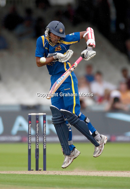 Dinesh Chandimal fends off a ball from Stuart Broad during the third one day international between England and Sri Lanka at Lord's, London. Photo: Graham Morris (Tel: +44(0)20 8969 4192 Email: sales@cricketpix.com) 03/07/11