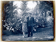 deteriorating emulsion photo with couple posing France circa 1920s