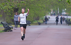 ©Licensed to London News Pictures 28/04/2020. Greenwich, UK. A man out running in cold wet weather today at Greenwich Park, Greenwich, London helps to keep people indoors on coronavirus lockdown. Photo credit:Grant Falvey/LNP