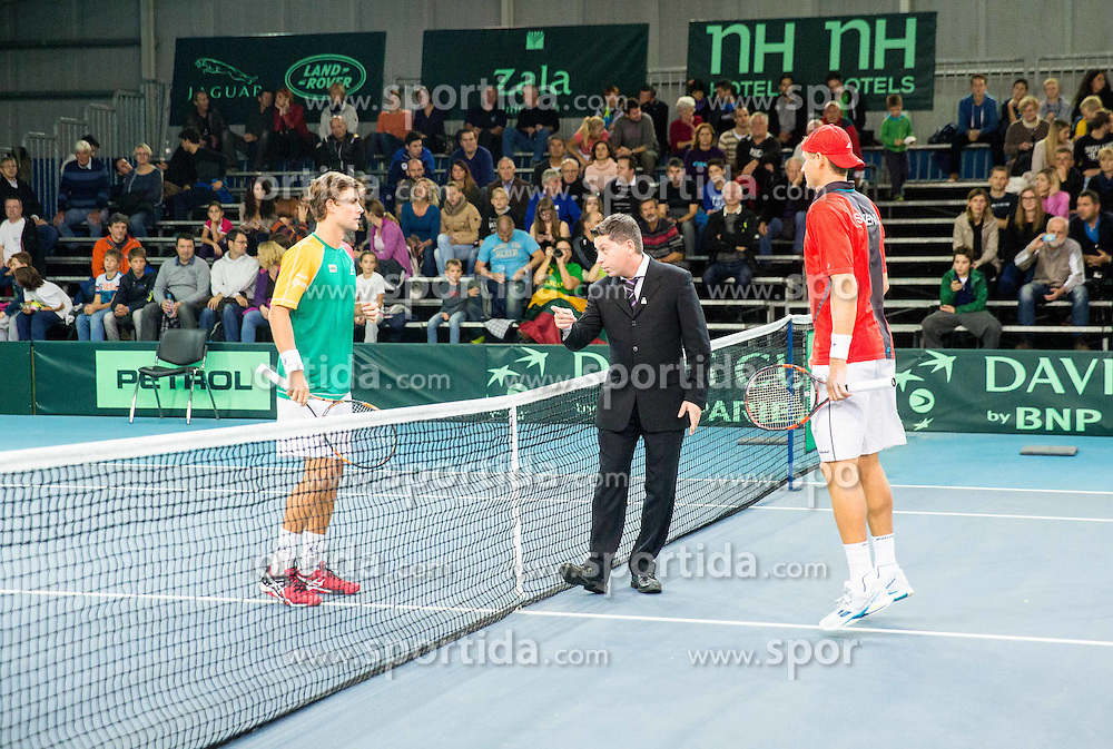 Laurynas Grigelis of Lithuania  and Blaz Rola of Slovenia during Davis Cup Slovenia vs Lithuania competition, on October 30, 2015 in Kranj, Slovenia. Photo by Vid Ponikvar / Sportida