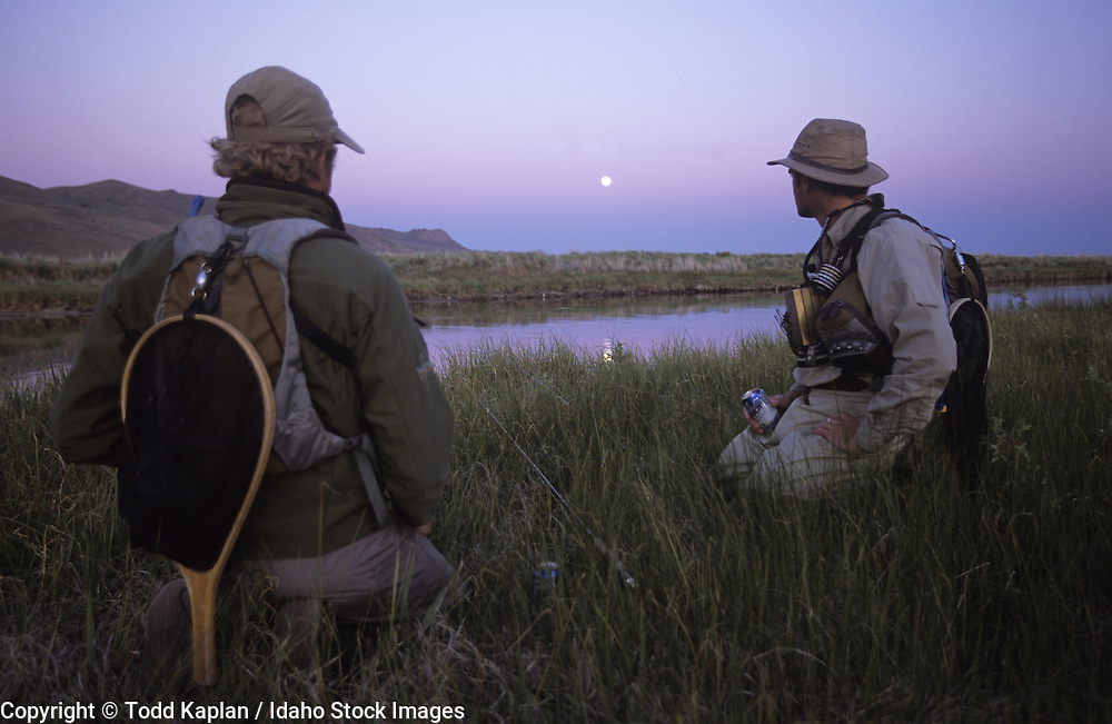 Idaho, near Sun Valley, Picabo, Silver Creek Preserve, Fly fishermen, summer, waiting for Brown Drake hatch, full Moon rising, sunset