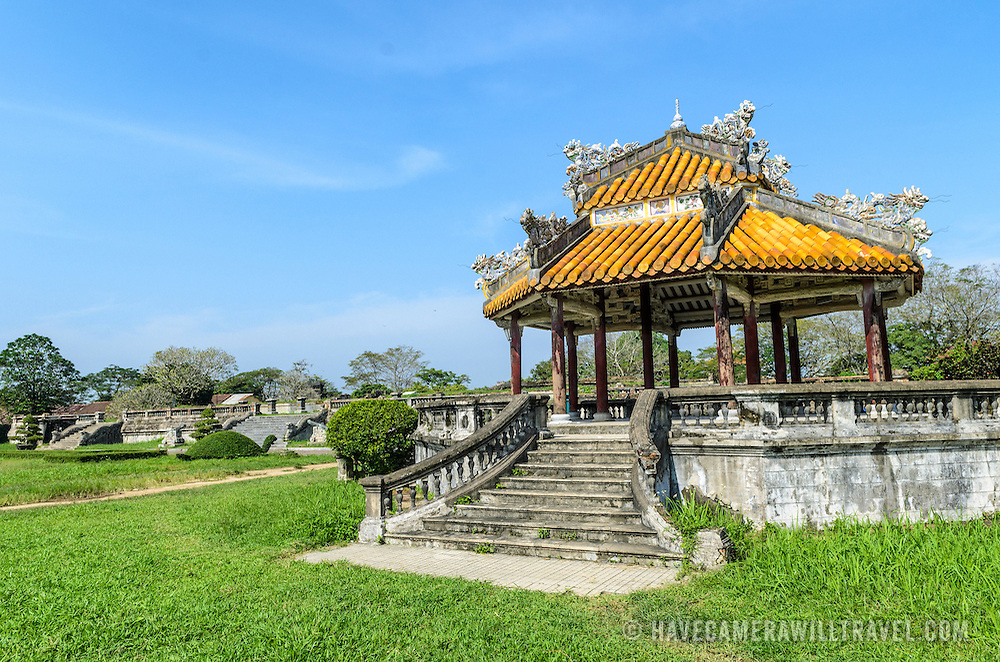 A pagoda in the courtyard at the Imperial City in Hue, Vietnam. A self-enclosed and fortified palace, the complex includes the Purple Forbidden City, which was the inner sanctum of the imperial household, as well as temples, courtyards, gardens, and other buildings. Much of the Imperial City was damaged or destroyed during the Vietnam War. It is now designated as a UNESCO World Heritage site.